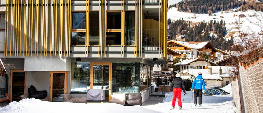 italy_dolomites_selva_mountain-design-hotel-eden_exterior-with-skiers.jpg